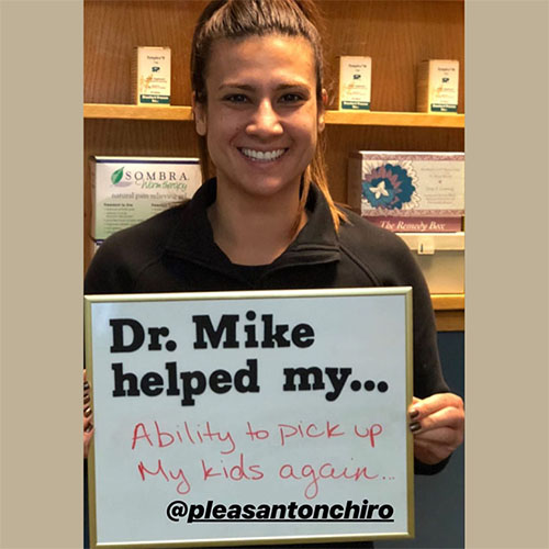Happy Patient who can now pick up kids after chiropractic treatment